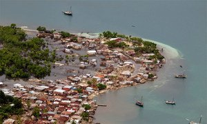 Hurricane Sandy passed to the west of Haiti causing heavy rains and winds, flooding homes and overflowing rivers.