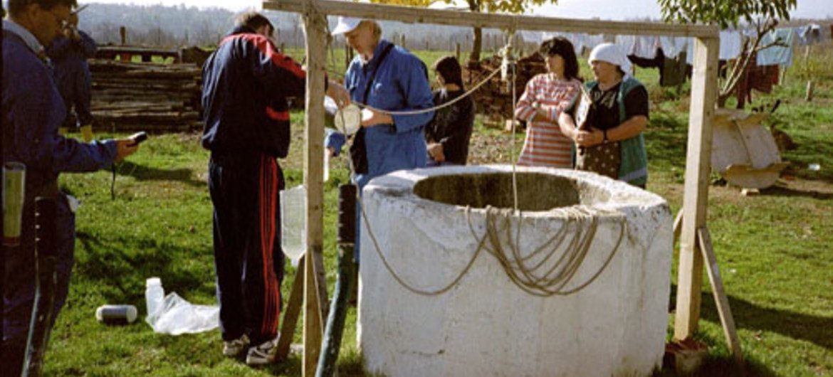 Collecting groundwater samples in Kosovo to test for depleted uranium.