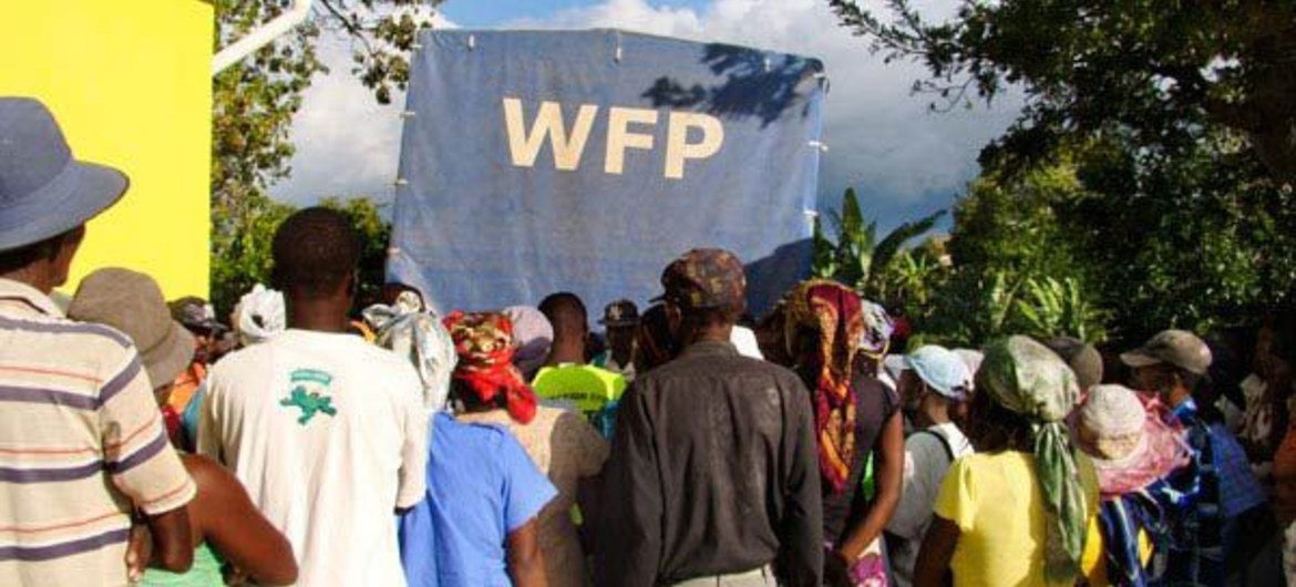 Haitians affected by Hurricane Sandy wait for food assistance.