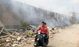 Piles of garbage being burned in the streets of Cairo, Egypt.