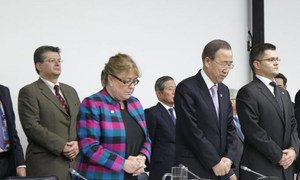 Secretary-General Ban Ki-moon (second right) and General Assembly President Vuk Jeremic (right) observing a moment of silence at the start of a briefing to the Assembly on the impact of Hurricane Sandy.