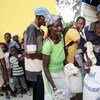 Haitians receive food rations following the passage of Hurricane Sandy.
