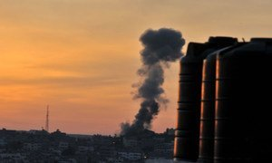 Smoke rises over the city following Israeli air strikes in Gaza.