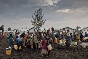 Displaced people gather around water taps in Mugunga 3.