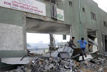 Young boys playing in the rubble of the Palestine Stadium in Gaza City which was the target of Israeli airstrikes.
