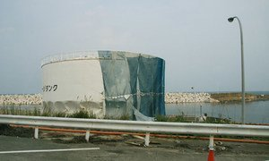 A liquid storage tank stands twisted at the Fukushima Daiichi Nuclear Power Plant.