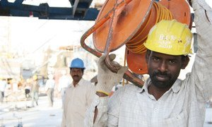 Migrants, such as these workers in Jordan, send remittances to their home countries.
