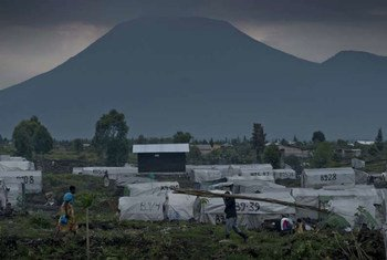 A volcano looms over Mugunga III camp in the DRC where food rations have been distributed to thousands of forcibly displaced people.