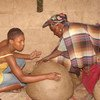 Earthenware pottery-making skills being passed on by pot master Mmasekgwa Motlhware to her granddaughter Tumediso in the Botswana's Kgatleng District.