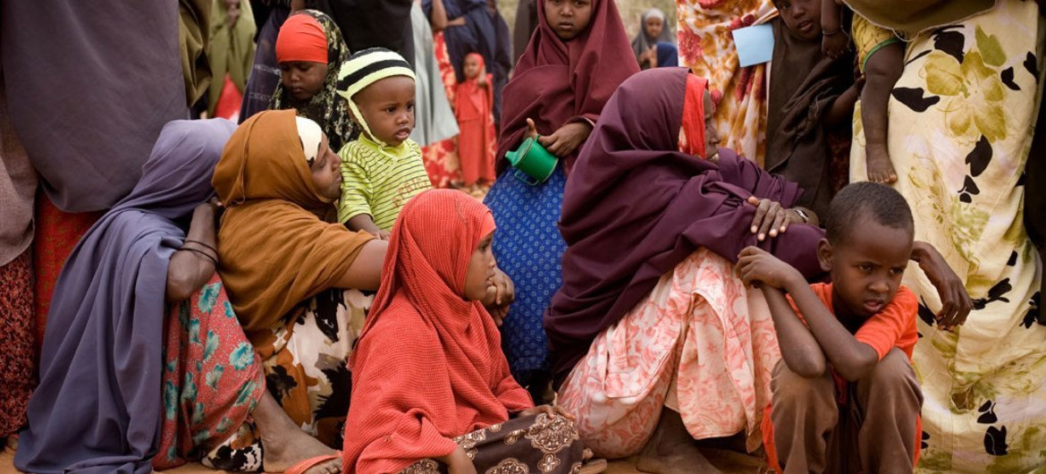 Women and children wait for assistance from the drought/famine in Dolo, southern Somalia.
