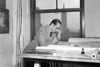 Oscar Niemeyer, one of the original architects of United Nations Headquarters in New York, going over plans for the building on 18 April 1947.