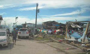People of Cateel in the Philippines start to clean up debris after Typhoon Bopha devastated the town.
