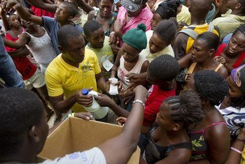 At a camp for displaced persons in Port au Prince, Haiti, residents get bleach and water purification tablets which are used in cholera prevention.