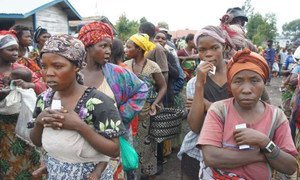 Women wait for food to be distributed at the Mugunga III camp in the Democratic Republic of the Congo (DRC).