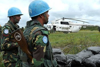 UN peacekeepers in South Sudan with one of their helicopters.