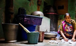 A domestic worker washes clothes by hand in New Delhi, India.