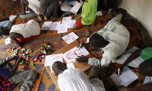 Former child soldiers draw in a UNICEF-assisted transit centre in the Central African Republic (CAR).