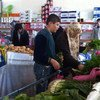 Syria refugees shop with the WFP food vouchers they received in Turkey.