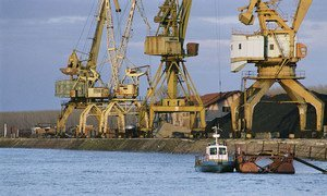Cranes loading freighters on the Danube River, Bulgaria.
