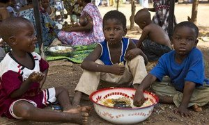 Displaced children in the Mali capital, Bamako, eat a welcome meal.
