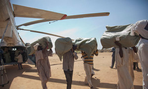 UNAMID delivers plastic tarps, sleeping mats, blankets and water purification equipment to civilians who were displaced in El Sereif.