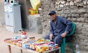 A poor Egyptian selling sweets to earn a living.