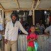 Somalies en un mercado en Kismayo  Foto;ONU/Stuart Price
