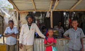Somalis stand in front of a kiosk in market area of the port city of Kismayo, south Somalia.