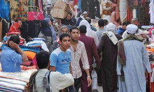 People passing through a busy market in Khan El-Khalili District, Cairo, Egypt. ILO/M. Crozet