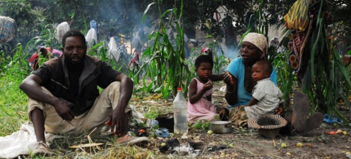 A family living in the open at Chihaquelane camp away three days after being flooded out of their home in Chokwe.