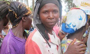 Displaced by fighting, these women queue up for food vouchers in the village of Minova, in Eastern DRC.