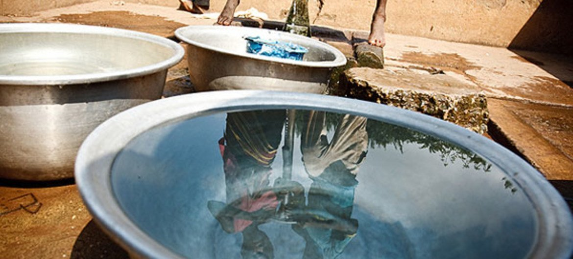 Collecting water at a pump in the Zanzan Region of Côte d'Ivoire.