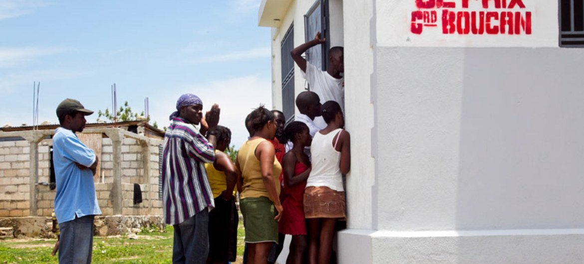 Haitians stand outside the Tribunal de Paix building in the town of Grand Boucan in May 2012.