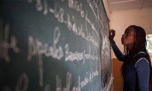 A student writes on a chalkboard at a school in Bamako, Mali.