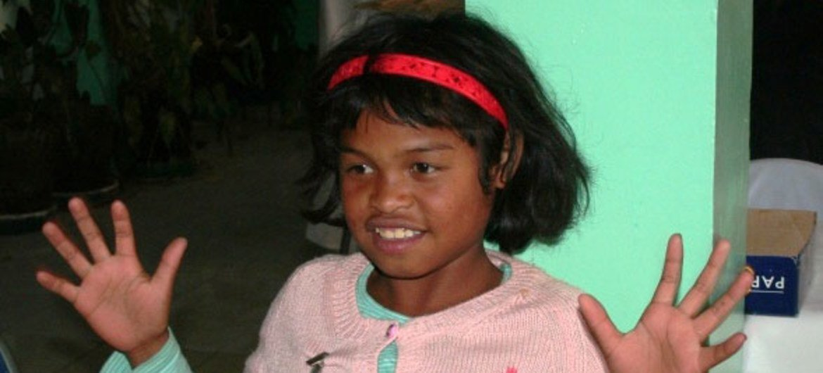 A child learning sign language in Madagascar in preparation for admittance to school.