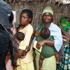 Mothers and their infant children at the Mwandama Millennium Village, Malawi.