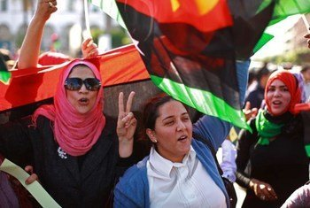 Libyan women participate in a demonstration in Tripoli calling for the disarming of armed groups.