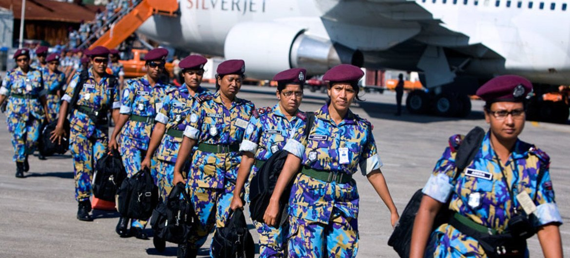 An all-female Formed Police Unit from Bangladesh, serving with the UN Stabilization Mission in Haiti, arrives in Port-au-Prince to assist with post-earthquake reconstruction.