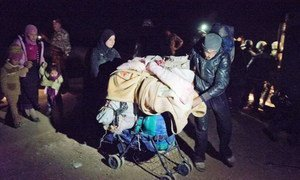 A group of Syrian refugees, making a risky journey by foot from the  governorate of Daá'ra, cross at night into Jordan.