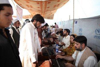 IDPs register at the Jalozai Camp, Pakistan.