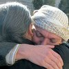 Gert Danielsen (facing camera), a UN staff member with UNDP, embraces a colleague after his release from captivity in Sana'a, Yemen in 2012.