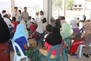 UNHCR staff speak with refugees from Myanmar in a shelter for women and children in Songkhla, southern Thailand.