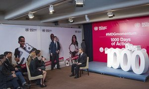Secretary-General Ban Ki-moon (right, seated) marks 1,000 days to the end of 2015 – the target date for achieving the Millennium Development Goals (MDGs).