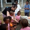 Katy Perry shows children how to wash their hands properly, during a visit a pre-school in the village of Sahavola in Analanjirofo Region, Madagascar.