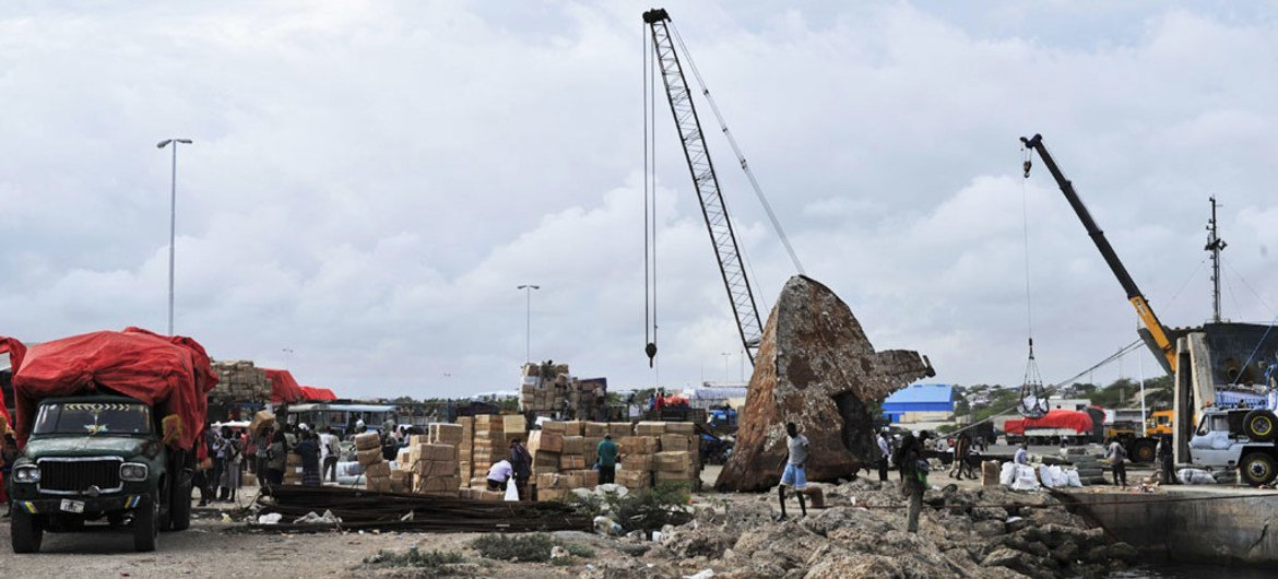 Workers offloading merchandise at the Mogadishu seaport.