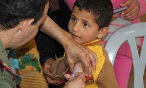 A Syrian boy gets his measles jab in Zaatari refugee camp in Jordan.