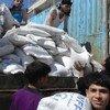 Une livraison de denrées alimentaires du PAM à Alep en Syrie.