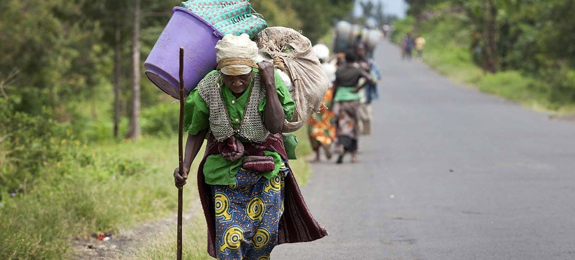 Villagers fleeing their homes in Sake, in the Democratic Republic of the Congo (DRC)'s North Kivu province, after fighting erupted between FARDC Government forces and rebel groups.