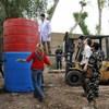 The UN in Iraq goes green: UNAMI staff installing a new biodigestor.