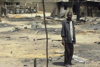 A man stands outside his destroyed home in Baga, Borno State, Nigeria, following heavy fighting between military forces from Nigeria, Niger and Chad, and Boko Haram.